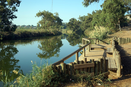 Wooden embankment on the river in Nahal Alexander national park in Israel