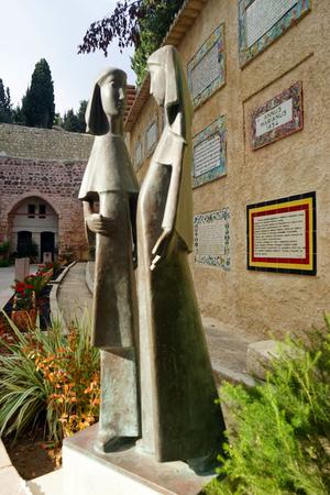 visitation: EIN KAREM, ISRAEL - CIRCA OCTOBER 2014 Two bronze sculptures near the wall in the inner yard of Visitation church Editorial