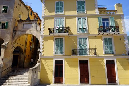 menton: Big arch and favade of building in Menton, France