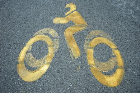 sine: Yellow sine of biker on the asphalt Stock Photo
