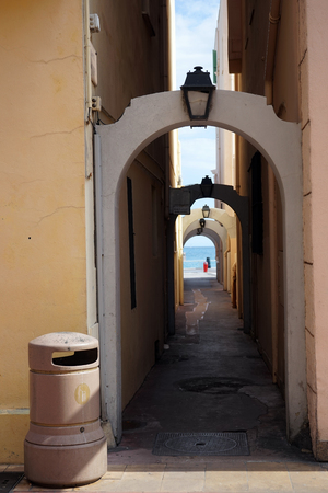 menton: Narrow street in Menton, France Stock Photo