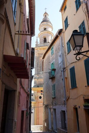 menton: Street and Saint-Michel church in Menton, France Stock Photo