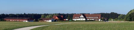 sheds: HECHINGEN, GERMANY - CIRCA AUGUST 2015 Farm house and sheds on the field
