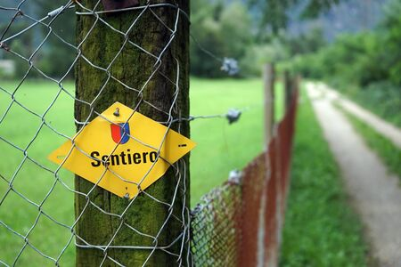 wooden trail sign: Sign of walking trail on the wooden post in Ticino, Switzerland