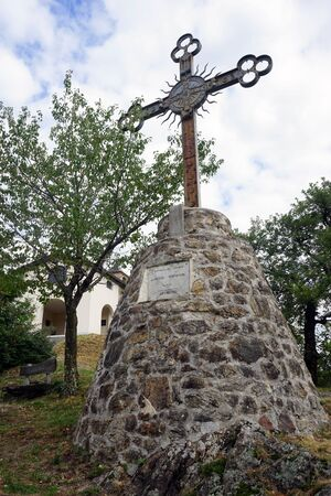 pedestal: Metal cross on the stone pedestal near Lugano, Switzerland Stock Photo