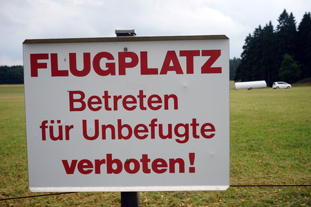 airstrip: Attention sign on the airstrip in Swabia, Germany