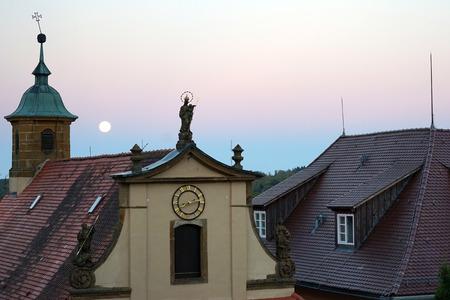 fool moon: KAPFENBURG, GERMANY - CIRCA AUGUST 2015 Fool Moon and church in Schloss Kapfenburg at night