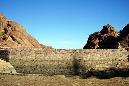 mountain oasis: Stone wall of dam on the mount Sinai in Egypt