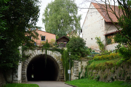tunel: DONAUWORTH, GERMANY - 1 SEPTEMBER 2015 Tunel and old houses Stock Photo