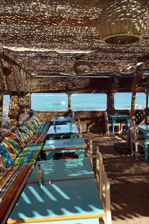 dahab: Tables on the beach under roof in Dahab in Egypt