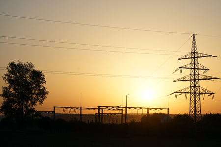 isolator: Tree and electrical station with sunset in Swabia, Germany