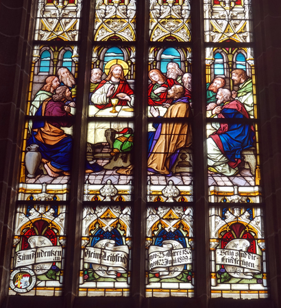crist: Lust Supper picture on the stained glass in church in Bad Uravch, Germany