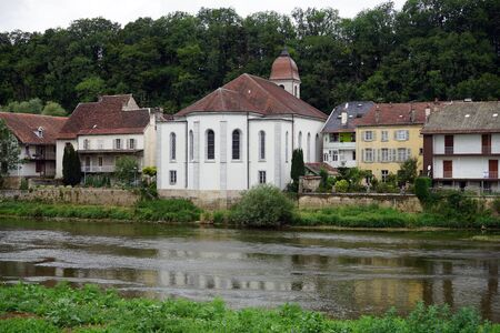 LISLE SUR LE DOUBS, FRANCE - CIRCA JULY 2015 Church and buildings on the river Doubs