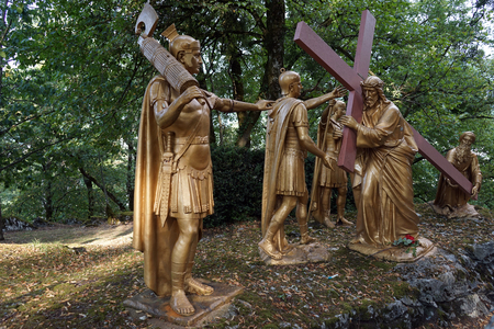 crist: LOURDES, FRANCE - CIRCA JULT 2015 Crist with cross and roman solgers