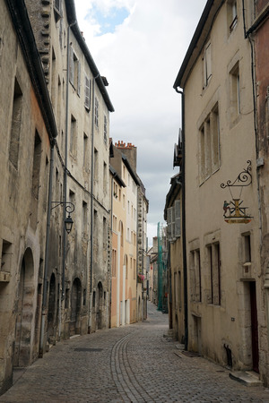 on the dole: DOLE, FRANCE - CIRCA JULY 2015 Narrow street in Old town