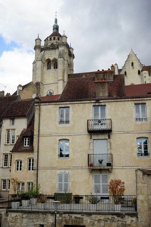 on the dole: DOLE, FRANCE - CIRCA JULY 2015 Collegiate Church of Our Lady and houses