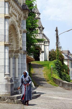 black nun: LESTELLE-BETHARRAM, FRANCE - CIRCA JULY 2015 Black nun walk near chapel