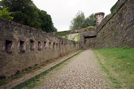 travel features: ST JEAN PIED DE PORT, FRANCE - CIRCA JULY 2015 Road near stone walls of fortress Stock Photo