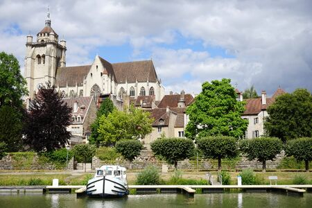 DOLE, FRANCE - CIRCA JULY 2015 Collegiate Church of Our Lady and pier on the river Doubs