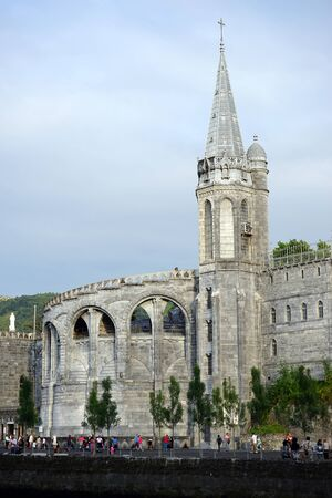 spire: LOURDES, FRANCE - CIRCA JULY 2015 Spire of basilica Notre-Dame de l�Immaculee-Conception Editorial