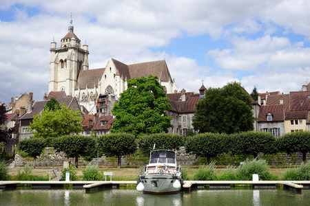 on the dole: DOLE, FRANCE - CIRCA JULY 2015 Collegiate Church of Our Lady and river Editorial