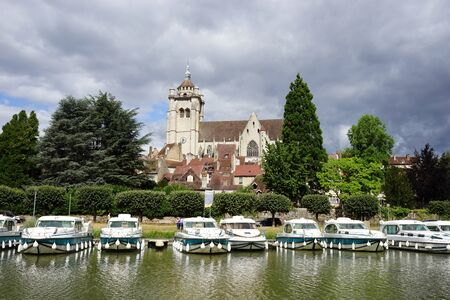 on the dole: DOLE, FRANCE - CIRCA JULY 2015 Collegiate Church of Our Lady and river Doubs