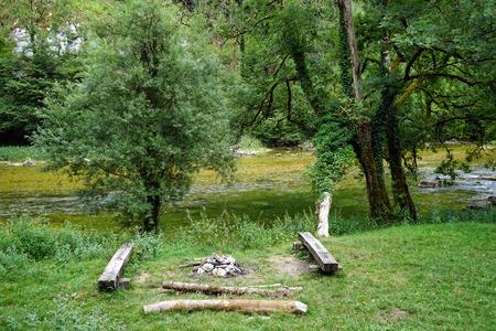 Fireplace near river Doubs in Switzerland