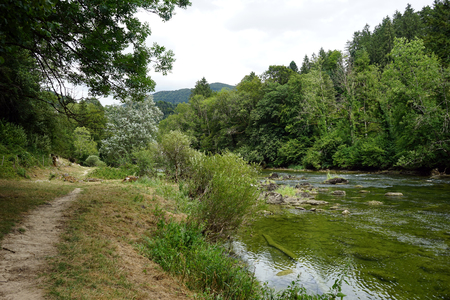 Footpath on the bank of river Doubs in Switzerland Stock Photo