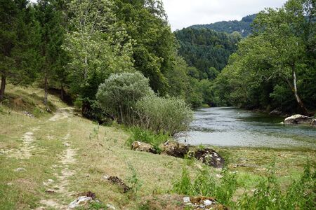 Footpath near river Doubs in Switzerland Stock Photo