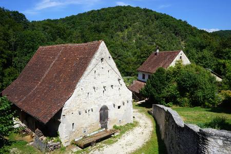farmhouses: DORMACH, SWITZERLAND - CIRCA AUGUST 2015 Farmhouses and wall of Dornach castle Editorial