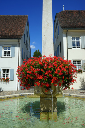 obelisk stone: DORMACH, SWITZERLAND - CIRCA AUGUST 2015 Fountain on the main street Editorial