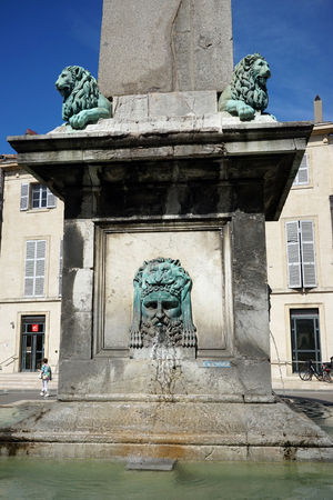 obelisk stone: ARLES, FRANCE - CIRCA JULY 2015 Fountain on the main square Editorial