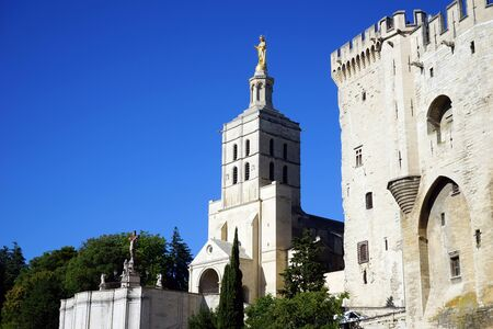 golde: Pope palace and golden statue in Avignon, France Editorial