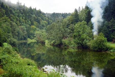 smock: Smock near the river Doubs Stock Photo