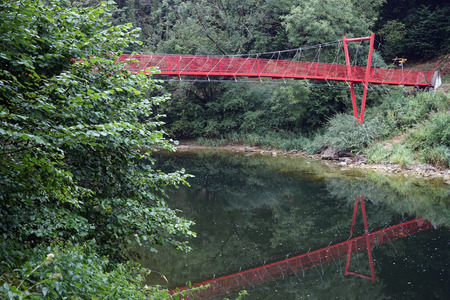 Red bridge on the river Doubs in Switzerland