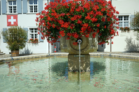 obelisk stone: DORMACH, SWITZERLAND - CIRCA AUGUST 2015 Fountain on the main square