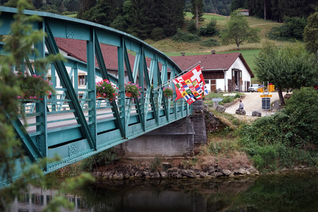 SOUBEY, SWITZERLAND - CIRCA JULY 2015 River Doubs and bridge