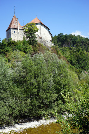 bailiwick: LAUPEN, SWITZERLAND - CIRCA AUGUST 2015 Castle on the rock. Here, already in 1324 Berne had its first bailiwick and thus constructed what is now one of the oldest buildings in the canton of Berne.