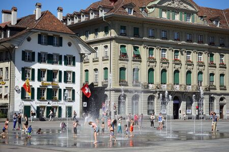 parliament square: BERN, SWITZERLAND - CIRCA AUGUST 2015 Children and fountain on the Parliament Square Editorial