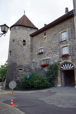 heritage protection: MURTEN, SWITZERLAND - CIRCA AUGUST 2015 Gate and tower of old castle