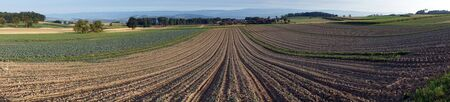 the ploughed field: Panorama of ploughed field in Switzerland Stock Photo