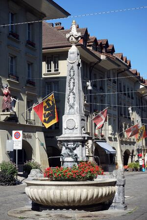 obelisk stone: BERN, SWITZERLAND - CIRCA AUGUST 2015 Fountain with obelisk on the main street -  Marktgasse Editorial