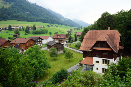 ascetic: FLUELI-RANFT, SWITZERLAND - CIRCA AUGUST 2015 Main street of village famous of hermit and ascetic Niklaus von Flue, also known as Brother Klaus.