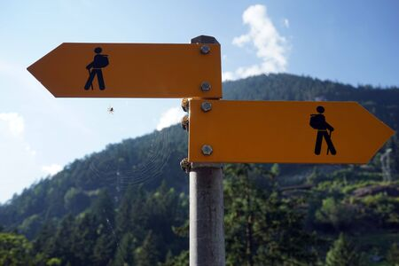 metal post: Sign of hiking trail on the metal post in mountain area in Switzerland Stock Photo