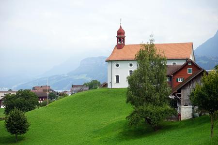 parish: BECKENRIED, SWITZERLAND - CIRCA AUGUST 2015 Parish church on the hill