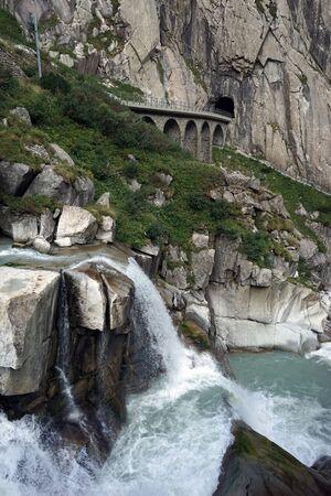 rive: Railway bridge and mountain rive near Andermatt in Switzerlandr