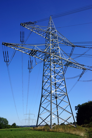 isolator high voltage: High pylon with electrical wire on the field in Swabia, Germany Stock Photo