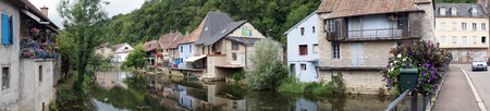 LISLE SUR LE DOUBS, FRANCE - CIRCA JULY 2015 River Doubs, houses and bridge