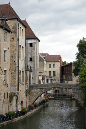 dole: Old town Dole with bridge and canal Stock Photo