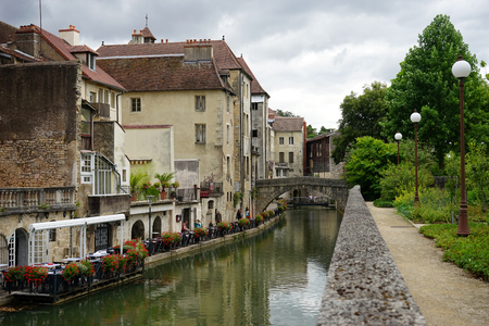 on the dole: DOLE, FRANCE - CIRCA JULY 2015 Canal with bridge in Old town